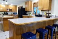 Kitchen with peninsula and bar stools